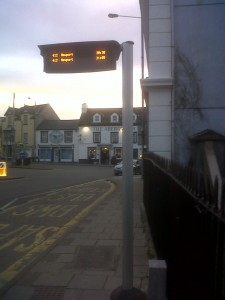 Fishguard Square, evening, bus sign trials 1