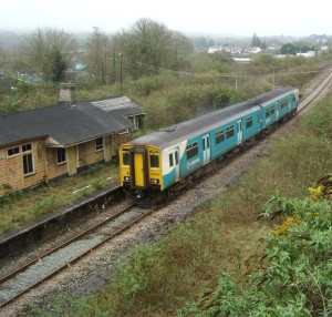 train running through closed Fishguard & Goodwick station