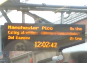 departure board showing Manchester train