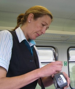 train conductor issuing tickets