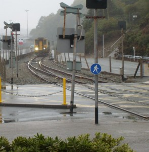 train approaching the level crossing at Fishguard Harbour