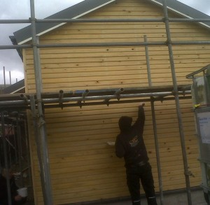 preparing timber cladding at the station building