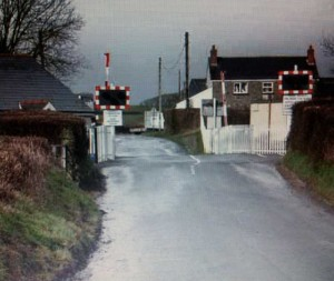 Llanboidy level crossing showing warning sign protruding into road
