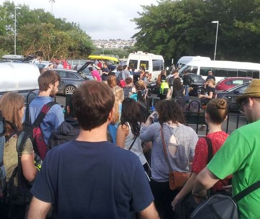 crowd of passengers in car park